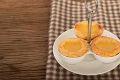Baked egg tart on tray Stock Photo