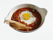 Baked egg with tomato sauce Stock Photo