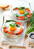 Baked egg with tomatoes and spinach Royalty Free Stock Images