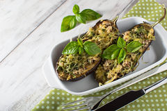 Baked eggplant with basil and cheese. In light background Royalty Free Stock Photography