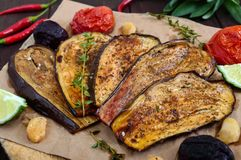 Baked eggplant with herbs and spices. Vegetarian cuisine royalty free stock photography