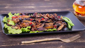 Baked eggplant with onions, garlic, red hot chili pepper and walnuts Royalty Free Stock Images