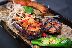 Baked eggplant with red pepper stock image