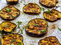 Baked Eggplant. Slices of baked eggplant/aubergine with spice and herbs stock image