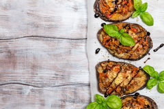Baked eggplant stuffed with vegetables and cheese Stock Photos