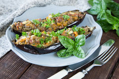 Baked eggplant stuffed with vegetables, meat and cheese Stock Photo
