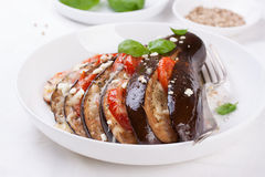 Baked eggplant with tomatoes, cheese and italian herbs Royalty Free Stock Photography