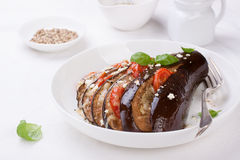 Baked eggplant with tomatoes, cheese and italian herbs Stock Images