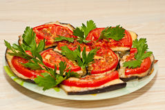 Baked eggplant with tomatoes Stock Image