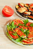 Baked eggplant with tomatoes Stock Images