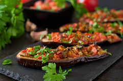 Baked eggplant. With tomatoes, garlic and paprika stock image
