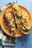 Baked eggplant and zucchini boats above view Stock Image