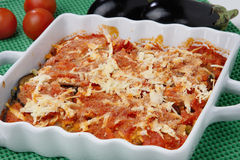 Baked eggplants with tomato and cheese. On plate Stock Photo