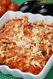 Baked eggplants with tomato and cheese. On plate Stock Photos