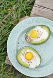 Baked eggs in avocado Royalty Free Stock Images