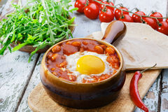 Baked eggs with beans Royalty Free Stock Photography