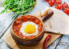 Baked eggs with beans Royalty Free Stock Images