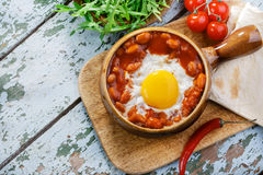 Baked eggs with beans Stock Image