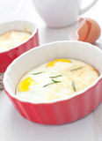 Baked eggs breakfast with herbs Stock Photo