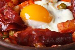 Baked eggs with chorizo, potatoes and tomatoes, macro Royalty Free Stock Image