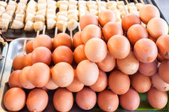 Baked eggs flavouring Stock Images