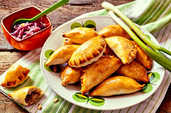 Baked Empanadas Served with Fresh Green Onions Stock Images
