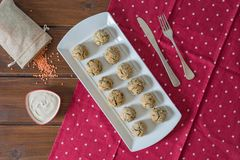 Baked falafel balls on a wooden table stock images
