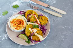 Baked falafel with hummus and vegetables. royalty free stock photo