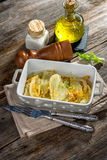 Baked Fennel with Parmesan. On wooden background royalty free stock photography