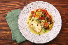 Baked feta cheese with cherry tomatoes Royalty Free Stock Photography