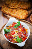 Baked feta cheese on vegetables Stock Photo