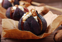 Baked figs with cheese,walnuts and honey Royalty Free Stock Image