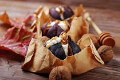Baked figs with cheese,walnuts and honey Stock Photo