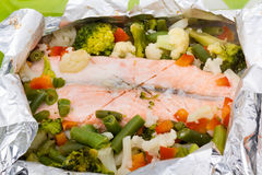 Baked Fillet of Fish in Foil with Vegetables Stock Photo