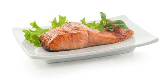 Baked fillet of trout with lettuce and basil Stock Images