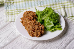 Baked fish cakes on a plate. Close up, horizontal, top view Stock Photography