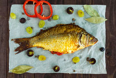 Baked fish carp, stuffed bell peppers and grapes. The top view Stock Photos