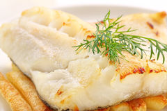 Baked fish and chips on white plate Stock Image