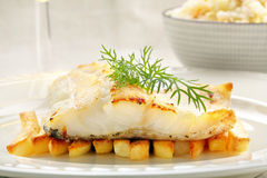 Baked fish and chips on white plate Royalty Free Stock Photography