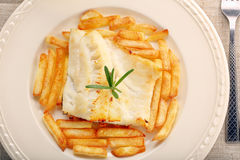 Baked fish and chips on white plate Stock Photography