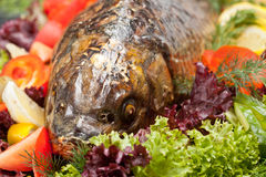 Baked fish. Decorated with vegetables and prepared for the Banquet Stock Photo