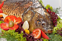Baked fish. Decorated with vegetables and prepared for the Banquet Stock Photos