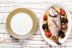 Baked in oven sea fish dorado stock images