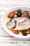 Baked in oven sea fish dorado stock image