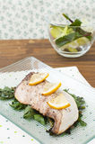 Baked fish fillet with lemon Stock Photo