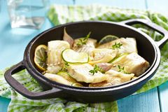 Baked fish fillet with lime and garlic Royalty Free Stock Images