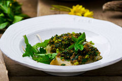 The baked fish fillet with a ramson Stock Photography
