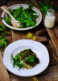 The baked fish fillet with a ramson Stock Images