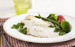 Baked fish fillet served with broccoli, green bean and potato Royalty Free Stock Images