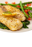 Baked Fish. Fillet on white background. Selective focus Stock Photos